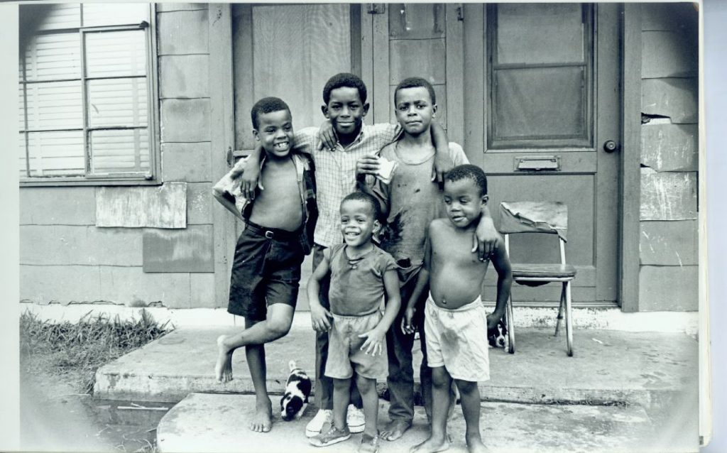 A black and white photograph depicted several young children standing in front of an apartment in Pleasantville (Lukes Collection, Rice University)